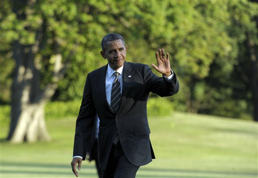 President Barack Obama waves as he walks from Marine One on the South Lawn of the White House in Washington on Wednesday after returning from campaigning.