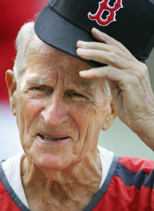 In this Aug. 31, 2006, file photo, Boston Red Sox great Johnny Pesky lifts his cap during a television interview before a baseball game against the Toronto Blue Jays in Boston. Pesky, who spent most of his 60-plus years in pro baseball with the Red Sox and was beloved by the team's fans, has died on Monday, Aug. 13, 2012, in Danvers, Mass. He was 92. (AP Photo/Michael Dwyer, File)