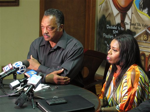 The Rev. Jesse Jackson, left, and Teresa Carter speak during a news conference on Wednesday in Memphis, Tenn., about the death of Carter's son, Chavis Carter while he was in police custody.