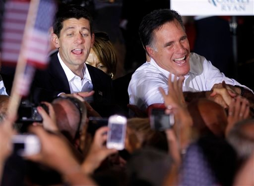 Republican presidential candidate Mitt Romney and vice presidential running mate, Rep. Paul Ryan, R-Wis., left, greet supporters, during a campaign rally in Manassas, Va. recently.