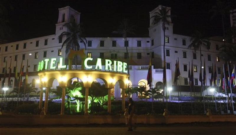 In this April 19, 2012 file photo, people walk past Hotel El Caribe in Cartagena, Colombia. The Associated Press photo