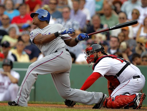 Texas Rangers' Adrian Beltre, left, hits a sacrifice fly off a pitch by Boston Red Sox's Alfredo Aceves, allowing Rangers' Elvis Andrus to score, in the ninth inning of a baseball game at Fenway Park in Boston, Wednesday, Aug. 8, 2012. The Rangers won 10-9. Red Sox catcher Kelly Shoppach, right, looks on. (AP Photo/Steven Senne)