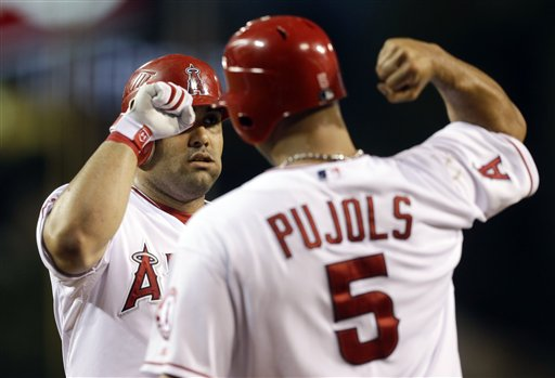 Los Angeles Angels' Kendrys Morales celebrates his two run home run with Albert Pujols (5) during first inning of an baseball against the Boston Red Sox in Anaheim, Calif., Wednesday, Aug. 29, 2012. (AP Photo/Chris Carlson)