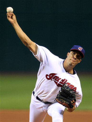 Cleveland Indians starting pitcher Ubaldo Jimenez delivers in the first inning of a baseball game against the Boston Red Sox, Thursday, Aug. 9, 2012, in Cleveland. (AP Photo/Tony Dejak)