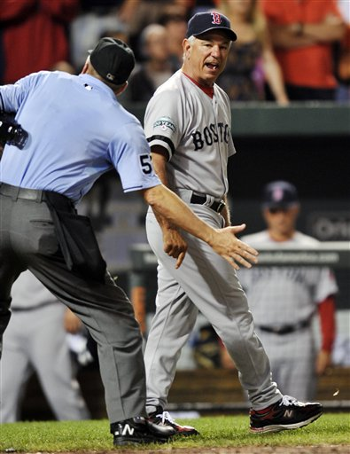 Boston Red Sox manager Bobby Valentine is ejected by home plate umpire Mike Everitt in the eighth inning of a baseball game against the Baltimore Orioles, Wednesday, Aug. 15, 2012, in Baltimore. The Orioles won 5-3. (AP Photo/Gail Burton)