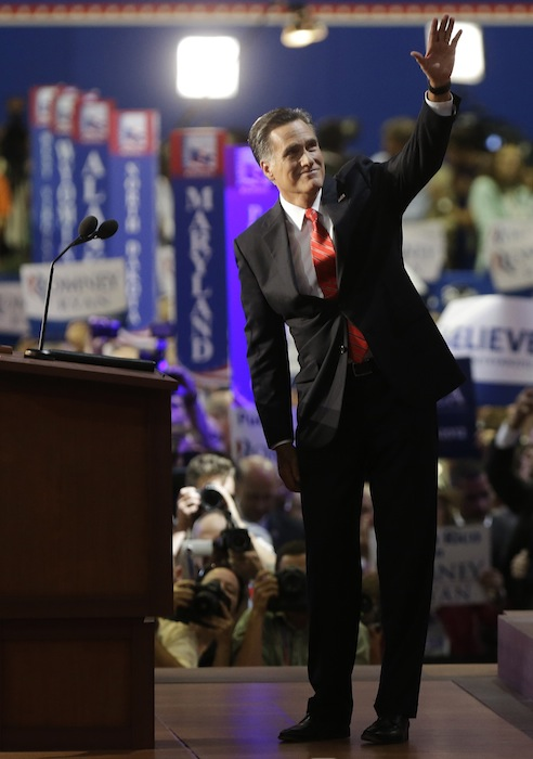 Republican presidential nominee Mitt Romney waves to delegates before speaking at the Republican National Convention in Tampa, Fla., on Thursday, Aug. 30, 2012. (AP Photo/Lynne Sladky)