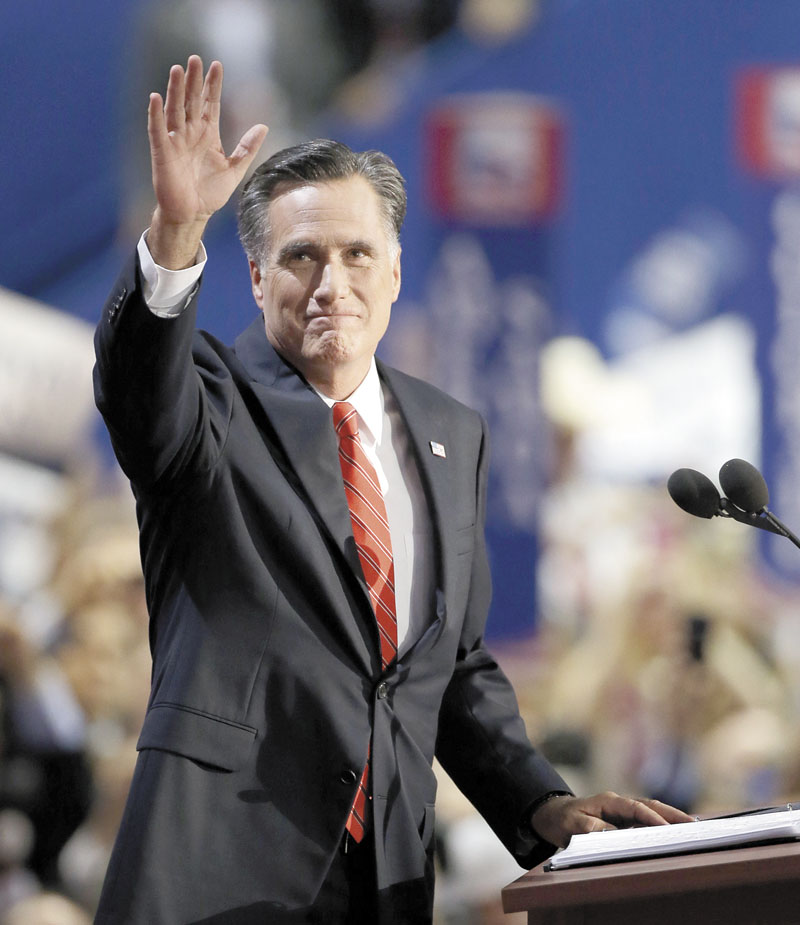 Republican presidential nominee Mitt Romney waves to delegates Thursday night before speaking at the Republican National Convention in Tampa, Fla.
