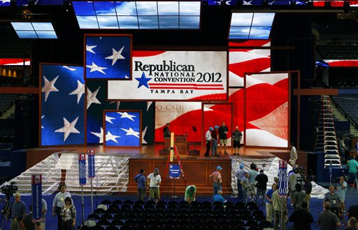 Workers prepare the stage for the Republican National Convention inside the Tampa Bay Times Forum in Tampa, Fla., on Saturday. GOP officials abruptly announced plans Saturday night to scrap the first day of their national convention, bowing to the threat of Tropical Storm Isaac.