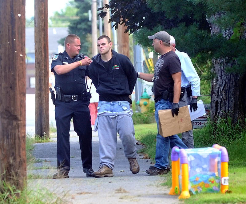 Waterville Police and Maine State Police apprehend two suspects on Pleasant Street in Waterville in connection to a Rite Aid robbery this morning.
