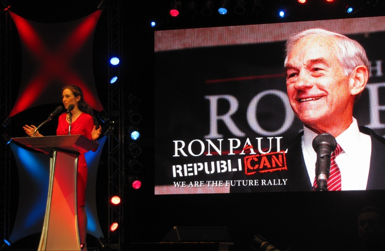 """Ashley Ryan of Maine speaks to Ron Paul supporters at the """"We Are the Future"""" rally at the University of South Florida Sun Dome in Tampa, Fla., on Sunday. She urged the crowd to """"keep fighting"""" and stay engaged in politics despite frustrations."""