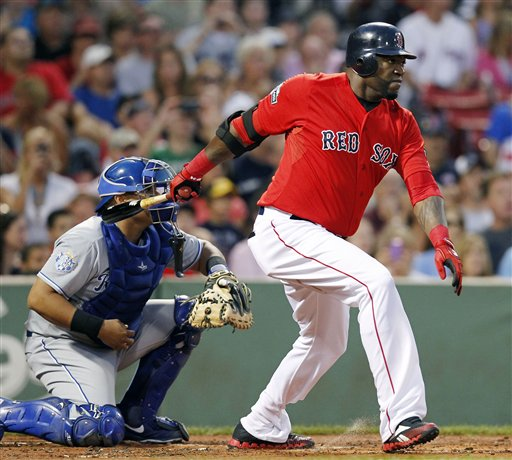 Boston Red Sox's David Ortiz, right, follows through on a two-run single in front of Kansas City Royals' Brayan Pena in the first inning of a baseball game in Boston, Friday.