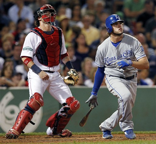 Kansas City Royals' Mike Moustakas, right, watches his two-run triple in front of Boston Red Sox's Jarrod Saltalamacchia in the seventh inning of a baseball game in Boston, Saturday.