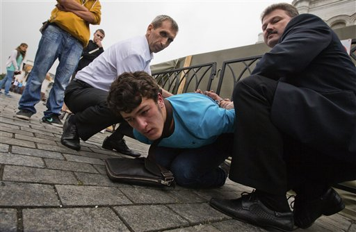 An unidentified supporter of Pussy Riot is detained by Christ the Saviour Cathedral security in Moscow on Wednesday.