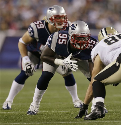 New England Patriots rookie defensive end Chandler Jones (95) lines up against New Orleans Saints tight end David Thomas (85) during their first NFL preseason football game against the New Orleans Saints in Foxborough, Mass., Thursday.