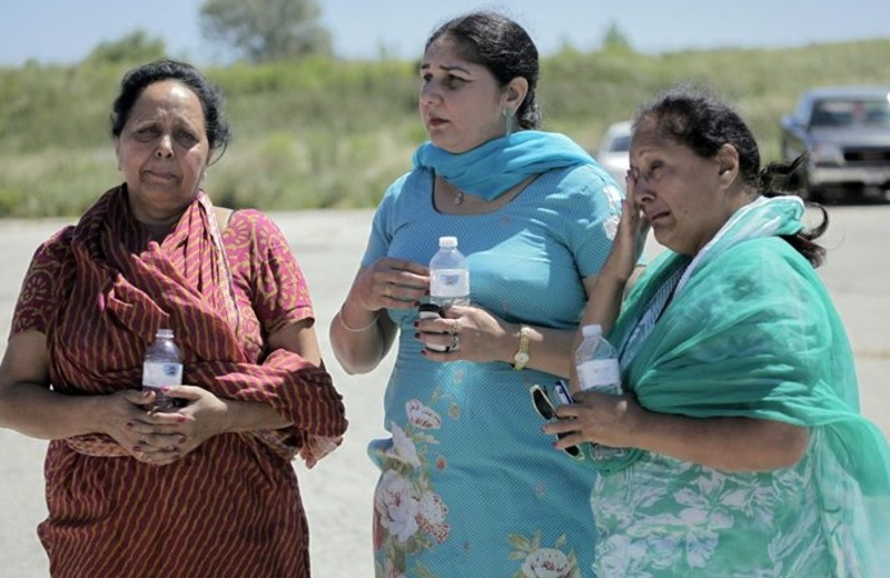 Women who said they family members were in the Sikh temple in Oak Creek, Wis., wait for information after a shooting there Sunday morning. Seven people were killed, including the shooting suspect.