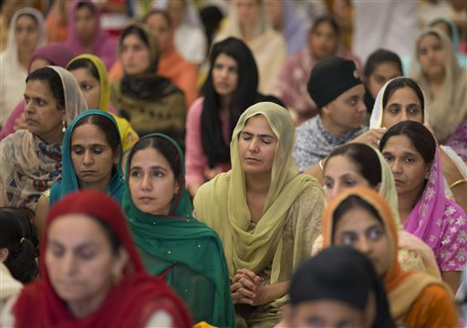 People attend a prayer service at the Sikh Temple of Wisconsin in Oak Creek, Wis., on Aug. 12, 2012, for the first Sunday prayer service since a white supremacist shot and killed six people there before fatally shooting himself.