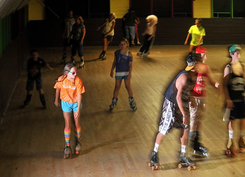 Staff Photo by Michael G. Seamans Dressed for the part in her rainbow knee-high socks and sunglasses, Brycie Bowser, 11, of Natic, Mass., roller skates with friends and family at Sunbeam Roller Rink in Smithfield on Friday, Aug. 8, 2012. The Sunbeam Roller Rink has become a landmark in Smithfield having served the roller skating needs of the since it was built in 1922.