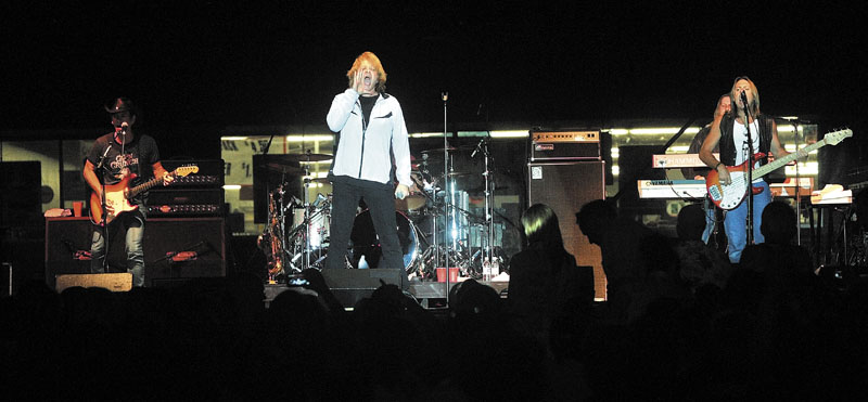 Eddie Money, center, performs at the Concourse in Waterville on Wednesday night.