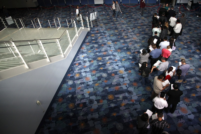 In this June 13, 2012 file photo, job seekers wait in line at a job fair expo in Anaheim, Calif. U.S. employers posted the most job openings in four years in June, a positive sign that hiring may pick up. The increase comes after employers added the most jobs in five months in July. (AP Photo/Jae C. Hong, File)