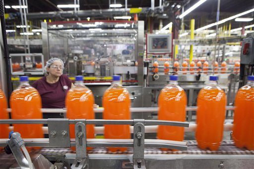 Bottles of Sunkist move down the line recently at the Dr Pepper Snapple bottling plant in Houston.