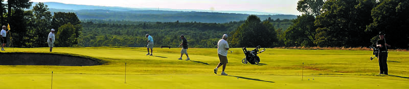 LOOKING WEST: Golfers play Tuesday at sunset at the Western View Golf Course in Augusta.