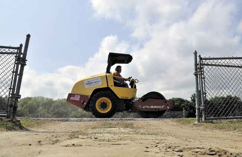 Tony Rossignol compacts the track at Winslow High School during a reconstruction project to renovate the track surface on Thursday.