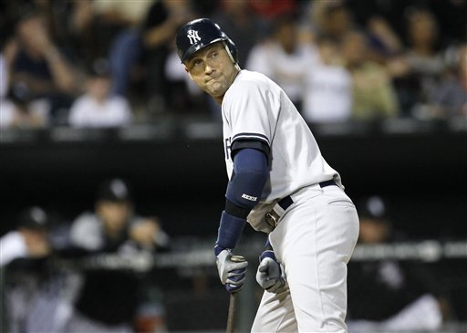 New York Yankees' Derek Jeter watches as Chicago White Sox right fielder Alex Rios catches his fly ball in foul territory during the third inning a game on Wednesday in Chicago.