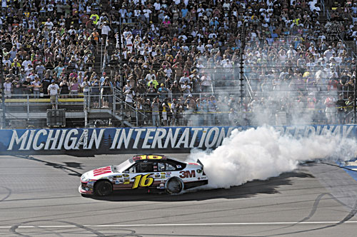 WINNER: Greg Biffle celebrates with a burnout after winning the NASCAR Sprint Cup Pure Michigan 400 at Michigan International Speedway on Sunday in Brooklyn Mich.