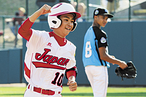 BIG HITTER: Japan's Noriatsu Osaka rounds the bases past Goodlettsville, Tenn., second baseman Lorenzo Butler (8) after hitting a walk-off, two-run home run in the fifth inning of the Little League World Series championship game Sunday in South Williamsport, Pa. It was his third home run of the game.