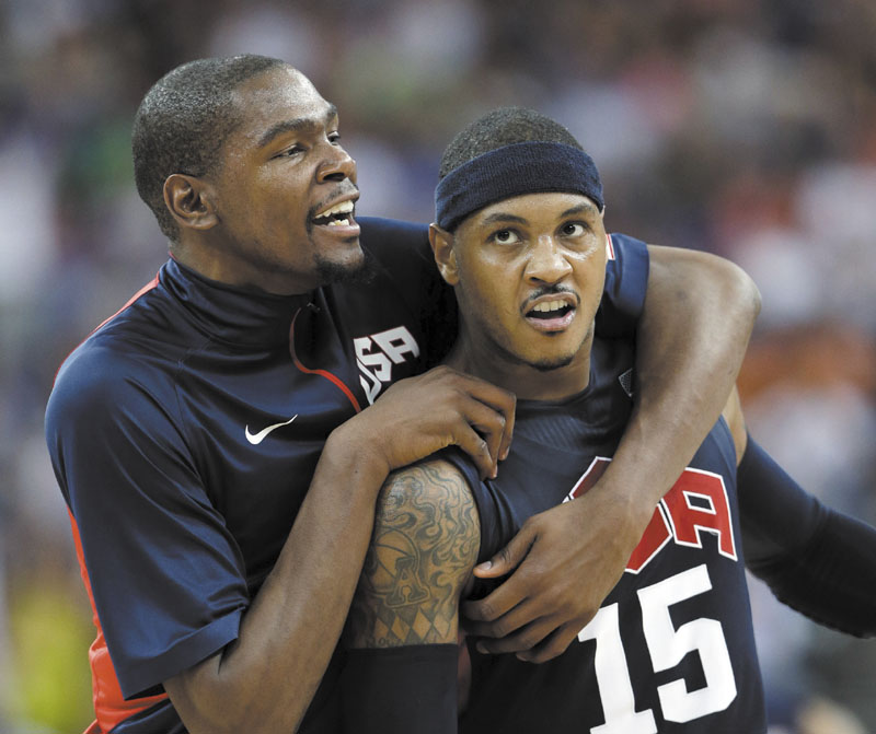 United States' Kevin Durant, left, celebrates with teammate Carmelo Anthony (15) after he scored during a semifinal men's basketball game against Argentina at the 2012 Summer Olympics, Friday in London. 2012 London Olympic Games Summe