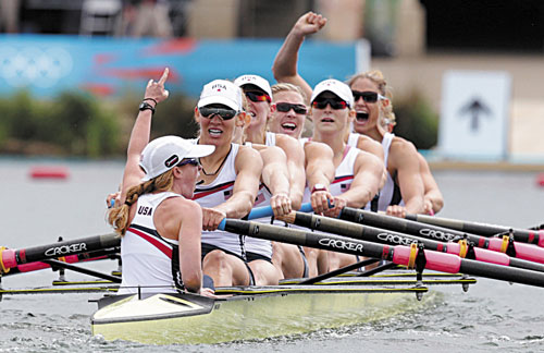 WE DID IT: U.S. rowers, front to back, Mary Whipple, Caryn Davies, Caroline Lind, Eleanor Logan, Meghan Musnicki, Taylor Ritzel, Esther Lofgren, Zsuzsanna Francia and Erin Cafaro celebrate after winning the gold medal for the women's rowing eight Thursday in Eton Dorney, England at the 2012 Summer Olympics.