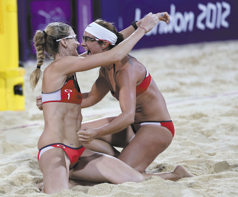 WE DID IT, AGAIN: United States' Misty May-Treanor, right, and Kerri Walsh Jennings, left, celebrate after winning their women's gold medal beach volleyball match Wednesday in London. 2012 London Olympic Games Summe
