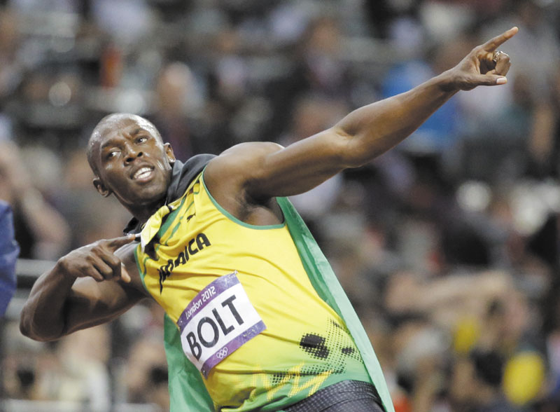 STILL THE MAN: Jamaica's Usain Bolt celebrates after winning the gold medal in the men's 100-meter final Sunday at the Olympic Stadium at the 2012 Summer Olympics in London. Bolt finished in an Olympic record time of 9.63 seconds. 2012 London Olympic Games Summe