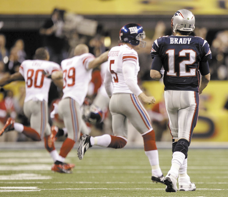BAD ENDING: New England Patriots quarterback Tom Brady walks off the field after the Patriots' 21-17 loss to the New York Giants in Super Bowl XLVI in Indianapolis.