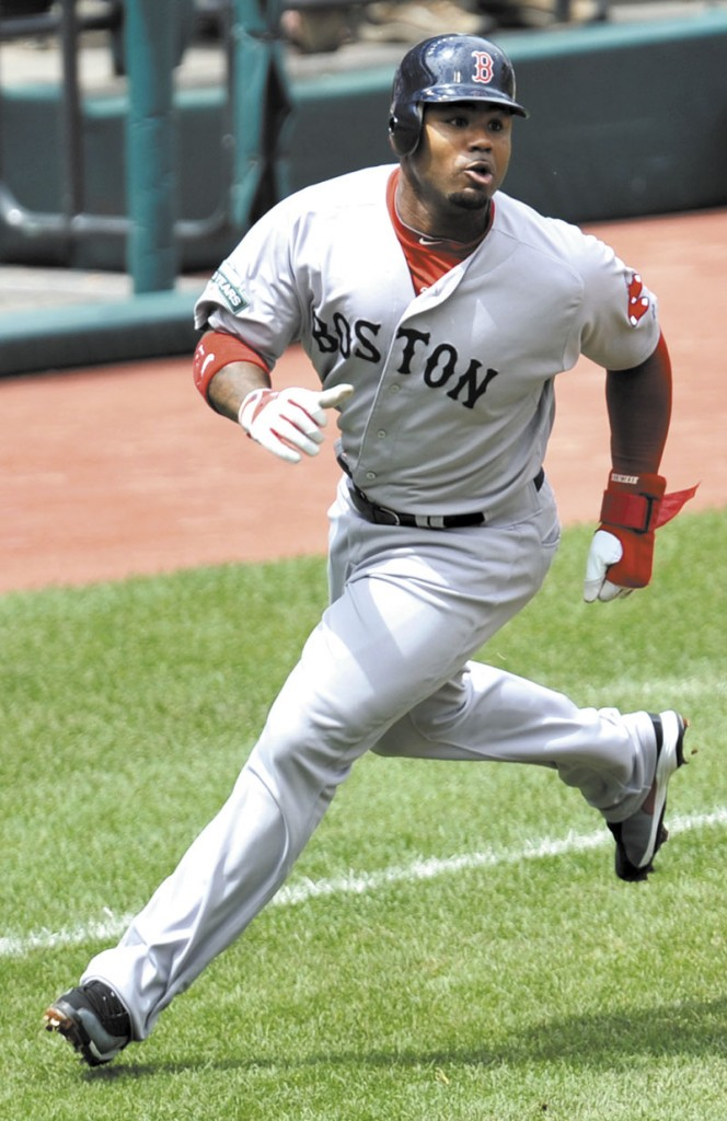 On the run: Boston's Carl Crawford rounds third base while scoring on a double by Dustin Pedroia during the Red Sox' 14-1 win over the Cleveland Indians on Sunday in Cleveland.