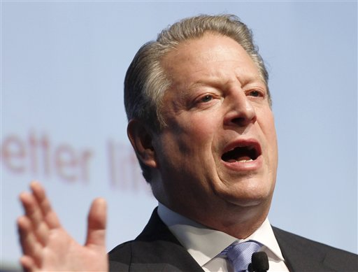FILE - In this Oct. 27, 2010 file photo, former US Vice President Al Gore speaks in Milan, Italy. Sarah Palin and George W. Bush won�t be in Tampa. Hillary Rodham Clinton and Al Gore aren�t making the trip to Charlotte. And scores of other Republican and Democratic stars are taking a pass as their parties gather at every-four-years national conventions. The reasons are varied _ and political. (AP Photo/Luca Bruno, File)