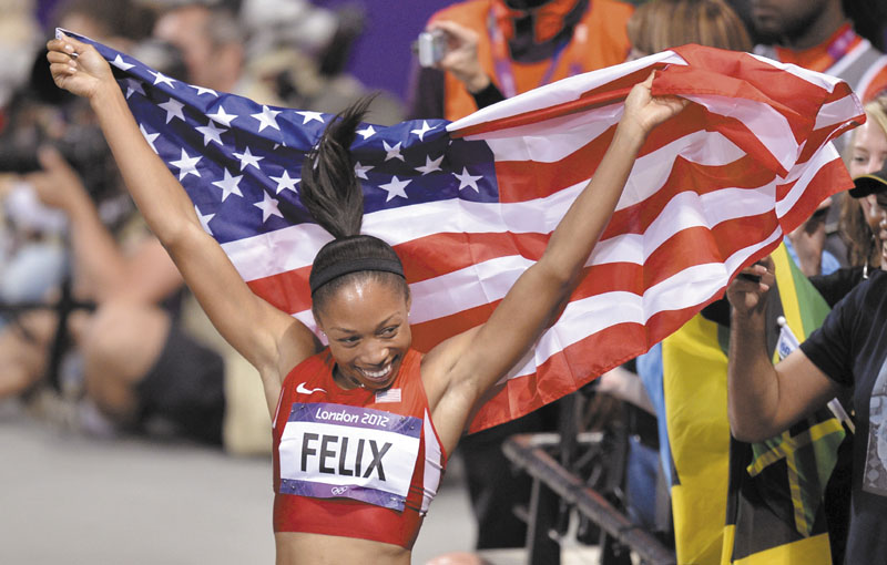 ALL SMILES: Allyson Felix of the United States celebrates her win in the women's 200-meter final Wednesday in the Olympic Stadium in London. 2012 London Olympic Games Summe
