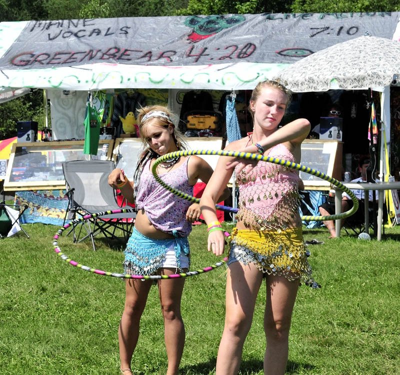 "Kendall Emerton, left, and Jordan Rousse dance with hoops to live music during the Hempstock Fest in Harmony on Sunday. Organizer Don Christen said the 22nd festival of camping and music draws people interested in ending prohibition of marijuana. ""The festival went well this year, though attendance was down from previous years,"" Christen said."