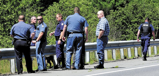 Law enforcement officers from several agencies prepare to spread out along Route 150 in Skowhegan in an effort to capture escaped Somerset County Jail inmate Dylan Perkins. The area searched by officers, a tracking dog and an airplane concentrated in the woods between Route 150 and the Steward Hill Road.