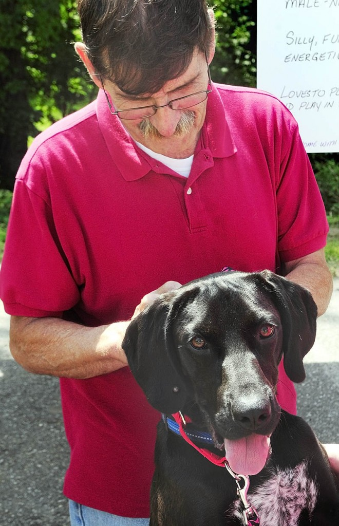 Ralph Rollins pets Balsamic at the Kennebec Valley Humane Society's Empty the Shelter adoption event Saturday in Augusta.