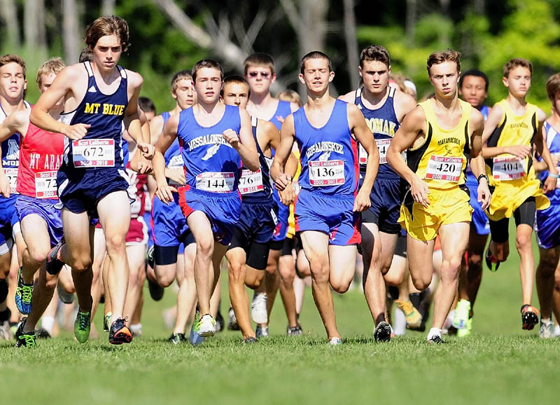 Mt. Blue's Justin Tracy, 672, left, was one of the early leaders as hundreds of runners take off at the start of the 2.4 mile course during the Scot Laliberte meet on Friday afternoon at Cony High School in Augusta.