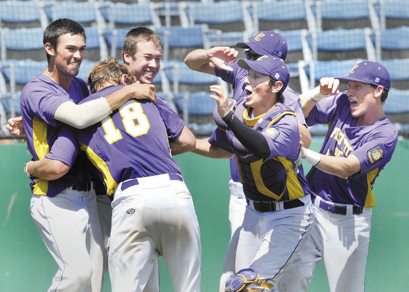 First Title's Harry Ridge, is mobbed by teammates after scoring the winning run in the bottom of the ninth inning as First Title beat Pastime 5-4 to win the American Legion Baseball state championship Monday at The Ballpark in Old Orchard Beach.