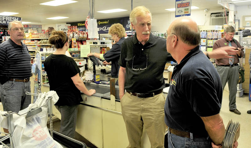 Former Maine Governor and independent candidate for U.S. Senate Angus King, center, speaks with Buddies Groceries co-owner George Rancourt on Monday during a campaign stop in Oakland.