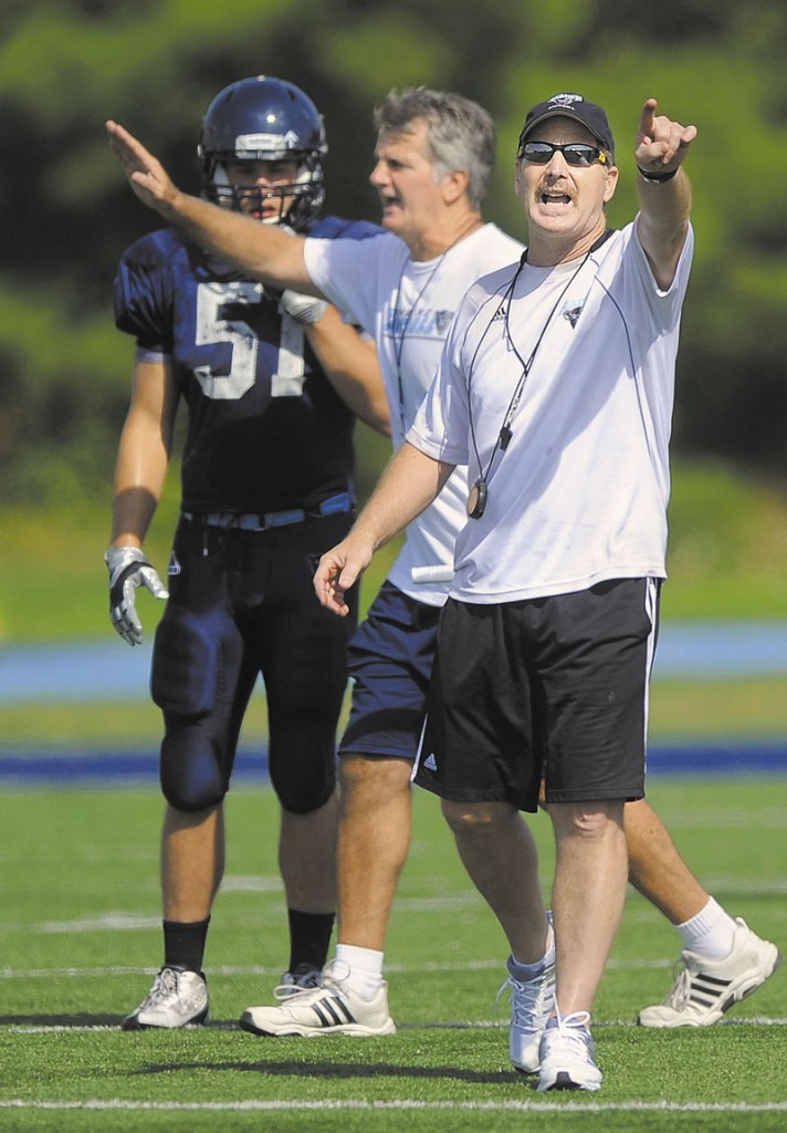 GLAD TO BE BACK: New University of Maine defensive coordinator Paul Ferraro, right, sought out the opportunity to join head coach Jack Cosgrove's staff in the offseason. Ferraro was a coach at Maine in 1989 before coaching for serval teams in the NFL.