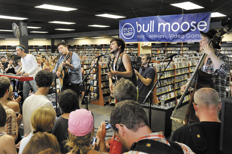 Mumford & Sons perform at Bullmoose Music in Scarborough on Friday, in preview to their Gentlemen of the Road show on Portland's Munjoy Hill today.