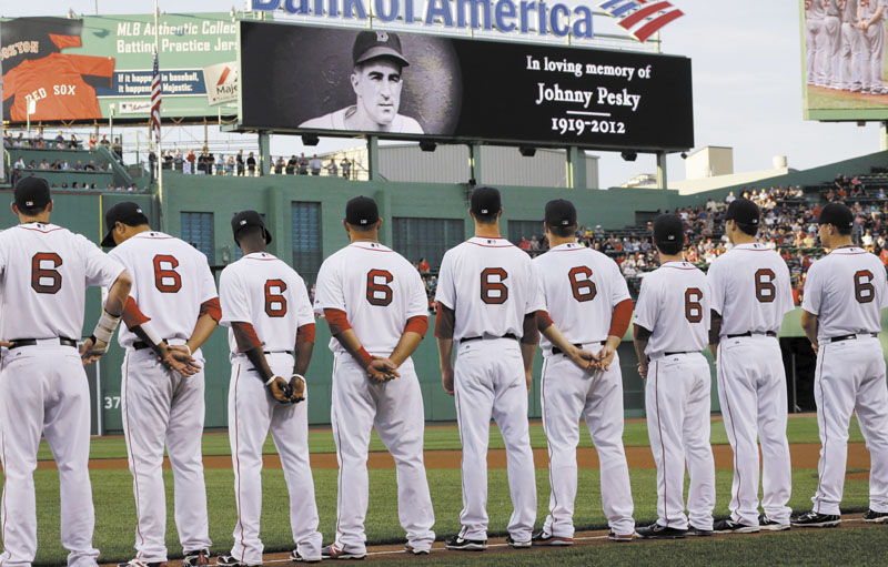HONORING NO. 6: Boston Red Sox players, all wearing No. 6 jerseys, line up on the field at Fenway Park to honor the late Johnny Pesky, prior to the Sox game against the Los Angeles Angels on Tuesday in Boston.