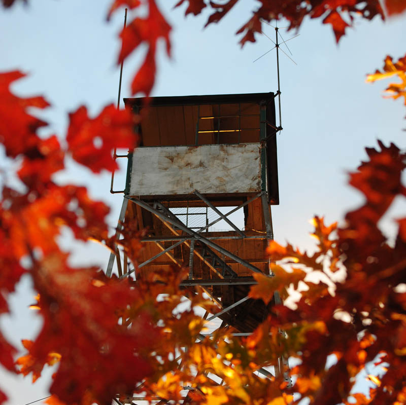 The 60-foot fire tower atop Mount Pisgah in Winthrop has been hit by vandals twice this year.