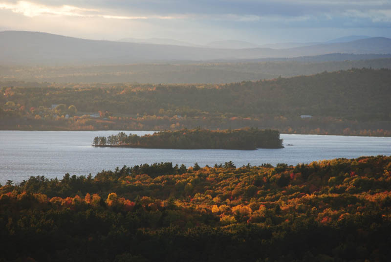 The fire tower on top of Mount Pisgah offers some of the best views in central Maine. This is a view to the west with Androscoggin Lake in the foreground and the White Mountains in the back.
