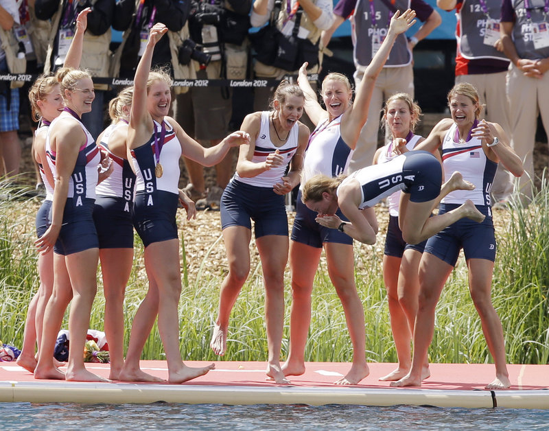 Eleanor Logan of Boothbay Harbor, fourth from left with arm raised, celebrates with her teammates Thursday as coxswain Mary Whipple gets tossed into the water following a gold-medal victory in the women's eight rowing event at the Olympics. It was a repeat gold for the team.