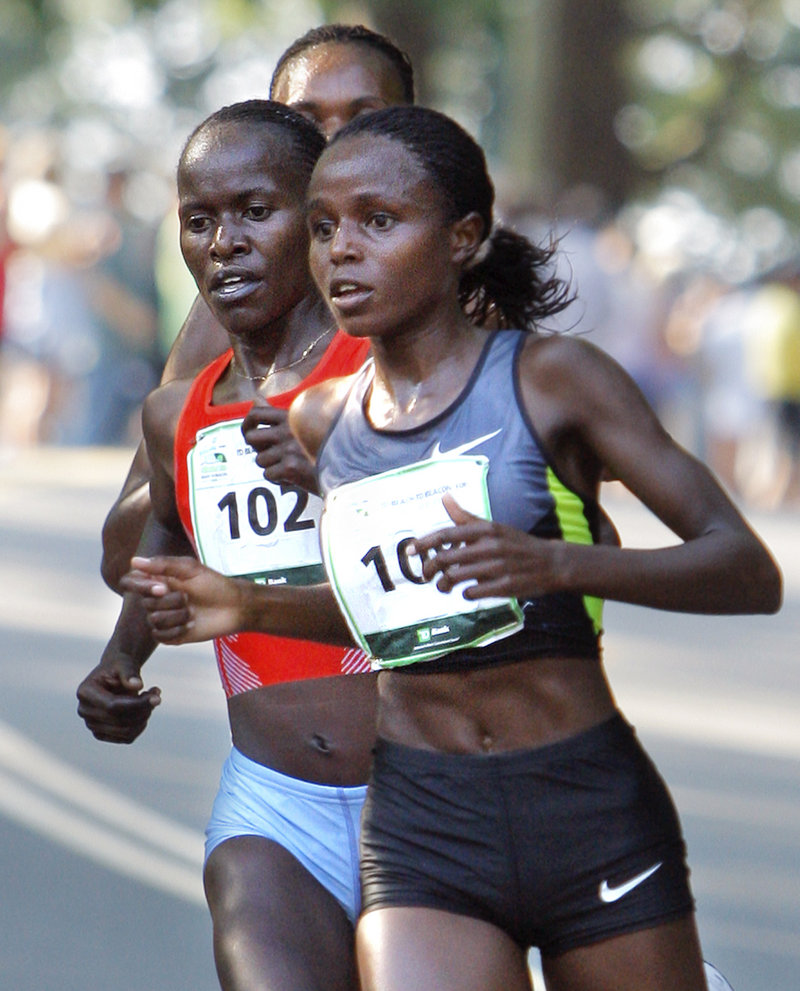 Margaret Wangari-Muriuki, right, clings to a tight lead over fellow Kenyans Lineth Chepkurui, left, and Rita Jeptoo during the Beach to Beacon 10K on Saturday in Cape Elizabeth. Wangari-Muriuki won the race with an official time of 31 minutes, 52 seconds, while Chepkurui finished third and Jeptoo fourth.